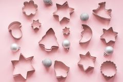 Christmas-themed cookie cutters.Christmas cookie cutters on pink. Holiday card. stock image