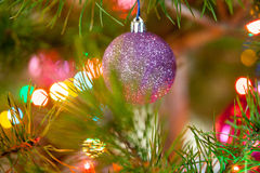 Various Christmas toys on a decorated evergreen tree Royalty Free Stock Images