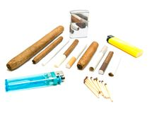 Various cigarettes, matches and lighters Royalty Free Stock Image