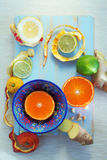 Various citrus fruits on blue cutting board Stock Photography