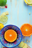 Various citrus fruits and ginger on blue cutting board Stock Images