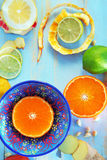 Various citrus fruits and ginger on blue cutting board Royalty Free Stock Photography