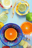 Various citrus fruits and ginger on blue cutting board Stock Photo