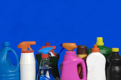 Various cleaning products in different colors. Various cleaning products with different colors and blue background stock photos