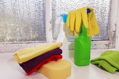 Various cleaning supplies for housekeeping. Cleaning humidity. Domestic life. Various cleaning supplies, housekeeping, Dirty Window full of Mold. Domestic set to stock image