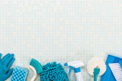 Various cleaning tools and tile.  royalty free stock photo