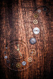 Various clock parts on a rustic wood Royalty Free Stock Photos