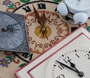 Various clocks on midnight or midday Royalty Free Stock Photography