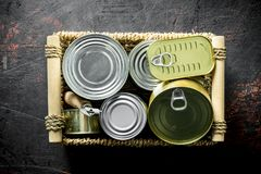 Various closed cans on tray royalty free stock photography