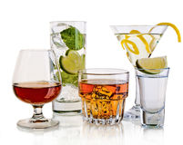 Various cocktails and alcohol on white background Stock Photos