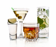 Various cocktails and alcohol on white background Stock Images