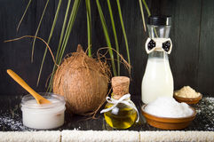 Various coconut products on black background Royalty Free Stock Photo