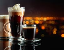 Various coffee drinks on a black background stock image