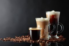 Various coffee drinks on a black background stock photo