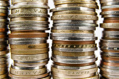 Various coins arranged in stacks Stock Photo