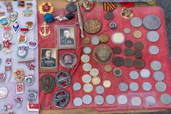 Various coins and badges for sale
