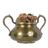 Various coins in brass goblet Royalty Free Stock Photos