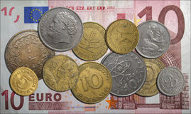 Various coins on 10 Euro banknote Stock Images