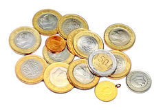 Various coins and a gold. Heap of various coins and a gold. Isolated on white background Royalty Free Stock Image