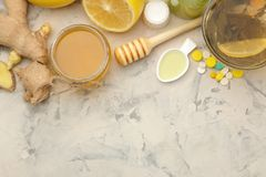 Various cold medicines and cold remedies on a white wooden table. Cold. diseases. cold. view from above royalty free stock photo