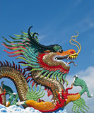 Various color dragons on blue sky , Royalty Free Stock Image