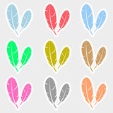 Various color feathers symbols stickers set Royalty Free Stock Images