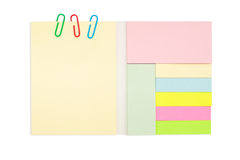 Various color note pad and paper clip isolated on Stock Images