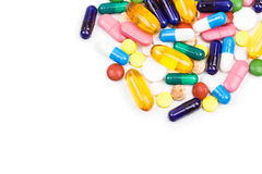 Various color pills and capsules close shot Royalty Free Stock Images