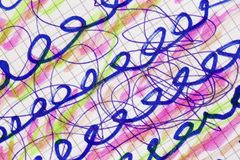 Defocused scribbles on a sheet of paper. Various color scribbles and strokes made with marker pen and highkighting pen on a sheet of paper. Defocused and royalty free stock images