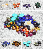 Various color stones. Photo set of assorted color gems on marble background Stock Photos