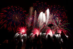 Various colored fireworks with silhouette of people. Royalty Free Stock Photos
