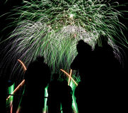 Various colored fireworks with silhouette of people. Stock Images