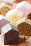 Various Colored House Blocks on Wooden Table Stock Photo
