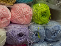 Various colored knitting yarn in the shop Royalty Free Stock Images