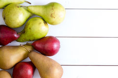 Various colored pears on table Stock Images
