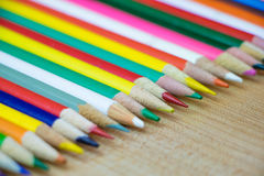 Various Colored Pencils in Row Stock Photo