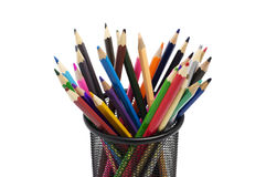 Various colored pencils standing in grilled pencil cup. Isolated over white Stock Image