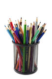 Various colored pencils standing in grilled pencil cup Stock Image
