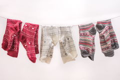 Various colored socks on a wire Stock Images