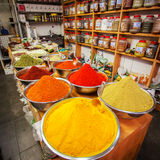 Various colored spices on the Mahane Yehuda Market in Jerusalem. Close-up of different spices in bowls to prepare delicious food. The counter on the Mahane Stock Photo