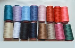 Various colored threads for cloth factory, weaving, textile production, clothing industry. stock photo