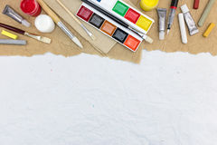 Various colorful artistic drawing tools on recycled paper backgr Royalty Free Stock Images