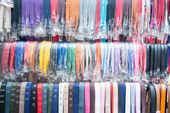 Various colorful belts for sale in shop Royalty Free Stock Photo