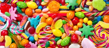 Various colorful candies, jellies, lollipops and marmalade Royalty Free Stock Photography