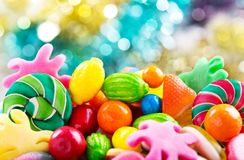 Various colorful candies, jellies, lollipops and marmalade Royalty Free Stock Photo
