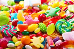 Various colorful candies, jellies, lollipops and marmalade Stock Photo