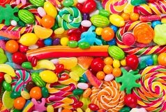 Various colorful candies, jellies, lollipops and marmalade Stock Images
