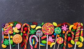Various colorful candies, jellies, lollipops and marmalade Stock Photography