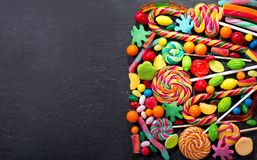 Various colorful candies, jellies, lollipops and marmalade Stock Photos