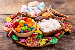 Various colorful candies, jellies, lollipops, marshmallows and m Royalty Free Stock Photo